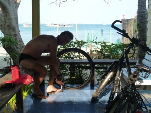 Johan repairing the second puncture on the island - we decided to no longer use our bikes for 'personal' reasons!