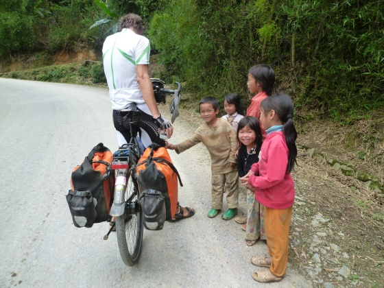 First these kids couldn't stop laughing about Johan's hairy legs and then they chased us up the hill