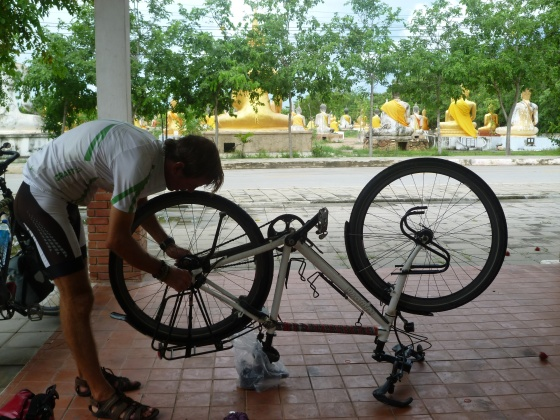 Johan fixing the bike in front of a temple